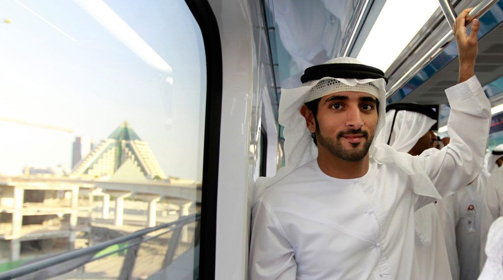 Dubai's Crown Prince Sheikh Hamdan bin Mohammed bin Rashid Al Maktoum rides the metro during the official launch of the Dubai Metro Green Line, September 9, 2011. Spanning 23 kilometres, the Green Line is the second line of the Dubai Metro network, and will run through heavily populated areas such as Deira and Bur Dubai. REUTERS/Jumana El Heloueh (UNITED ARAB EMIRATES - Tags: POLITICS TRANSPORT ROYALS ENTERTAINMENT) - GM1E79A05KN02