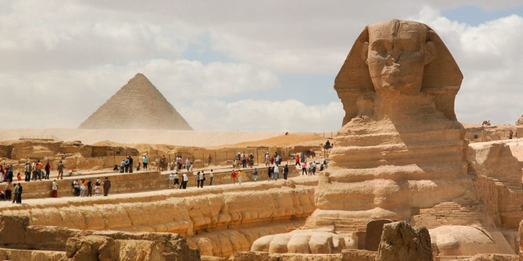 Great Sphinx of Giza (foreground) Pyramid of Menkaure (background). Cairo, Egypt, North Africa.